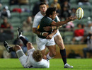 Will Chambers offloads in the tackle for the Australian Barbarians
