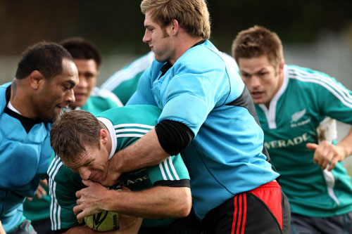 Brad Thorn is wrapped up during the All Blacks training session