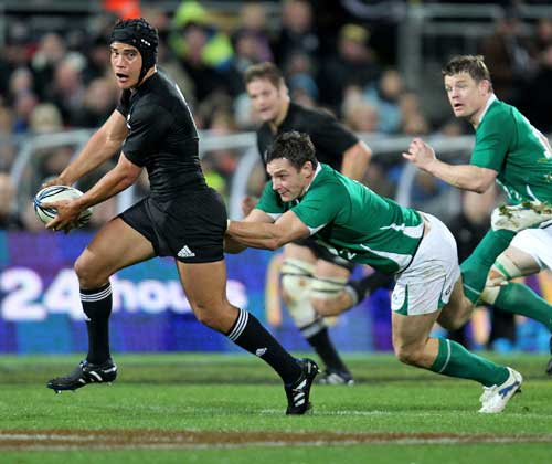 New Zealand's Benson Stanley beats the Ireland defence