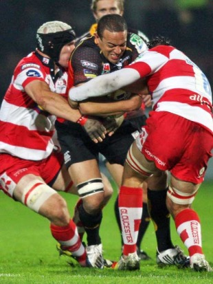 The Dragons' Gavin Thomas looks to protect the ball, Gloucester v Dragons, Heineken Cup, Kingsholm, Gloucester, England, October 9, 2009