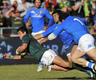 South Africa's Morne Steyn is felled by the Italy defence, South Africa v Italy, Puma Stadium, Witbank, South Africa, June 19, 2010