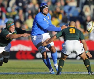 Italy's Marco Bortolami off loads the ball under pressure, South Africa v Italy, Puma Stadium, Witbank, South Africa, June 19, 2010