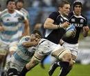 Scotland's John Barclary evades Argentina's Juan Martin Fernandez Lobbe
