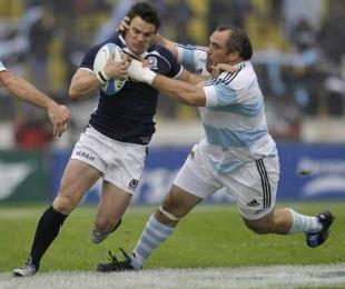 Argentina's Rodrigo Roncero tackles Scotland's Max Evans