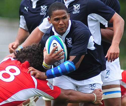 Namibia scrum-half Eugene Jantjies on the attack