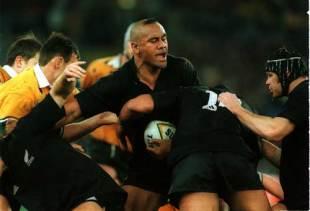 New Zealand winger Jonah Lomu stands firm against the Australia defence, Australia v New Zealand, Tri Nations, Stadium Australia, August 28 1999.
