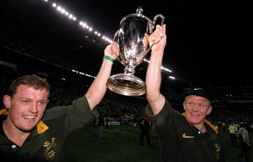 Adrian Garvey and Andre Venter lift the Tri Nations trophy