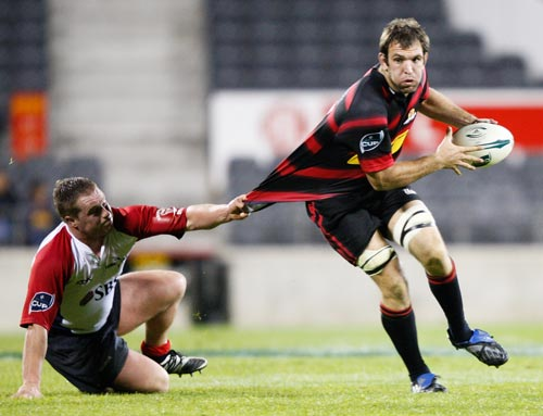 George Whitelock of Canterbury is tackled by Tristan Moran of Tasman