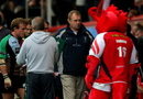 Harlequins head coach Dean Richards leaves the field after the Heineken Cup Round One match between Scarlets and Harlequins
