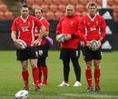 Wales fly-half Dan Biggar lines up a kick under the watchful eye of Stephen Jones