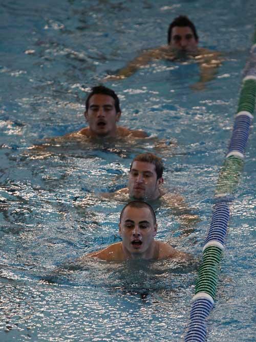 All Blacks Zac Guildford, Cory Jane and Benson Stanley swim