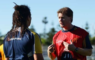 Referee Stuart Dickinson talks to Australia's Saia Faingaa