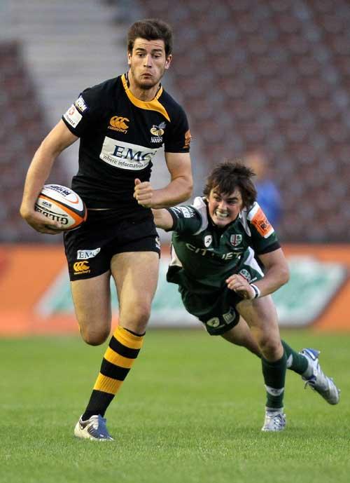Wasps' Mark Atkinson evades the London Irish defence