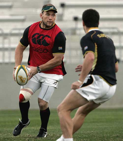 South Africa prop BJ Botha prepares to pass during training