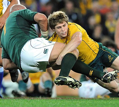 Australia wing James O'Connor drives South Africa prop Gurthro Steenkamp