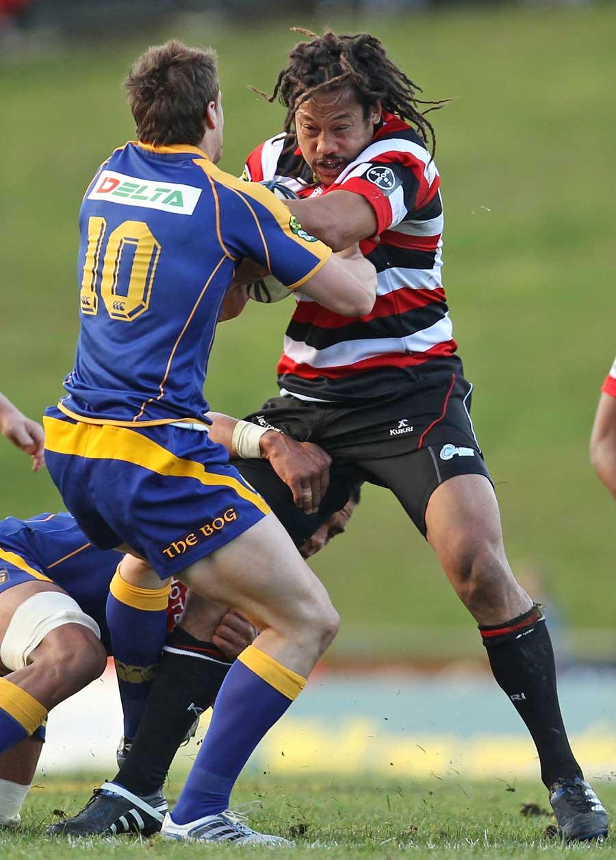 Counties Manukau's Tana Umaga fends off Otago's Chris Small