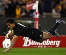 Mils Muliaina dives over for New Zealand's second try