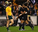 Mils Muliaina is congratulated by his All Blacks team-mates