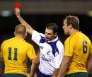 Referee Craig Joubert shows Australia's Drew Mitchell a red card