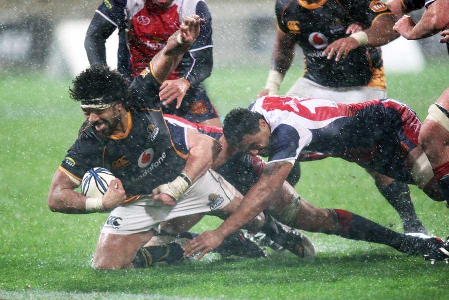 Wellington's Faifili Levave scraps against a Tasman tackler