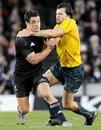 New Zealand fly-half Dan Carter fends off Adam Ashley-Cooper