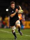 New Zealand skipper Richie McCaw breaks away to score