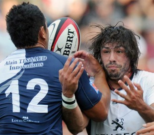 Toulouse fullback Clement Poitrenaud forces an offload