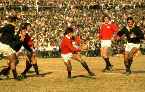 Andy Irvine of the Lions attacks the Springbok line