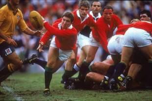 British and Irish Lions scrum-half Robert Jones fires a pass, Australia v British and Irish Lions, First Test, Aussie Stadium, July 1 1989.