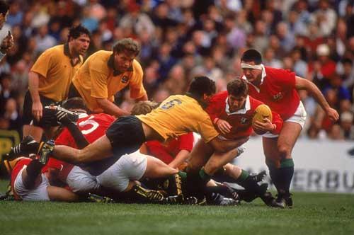 Robert Jones attempts to break a tackle