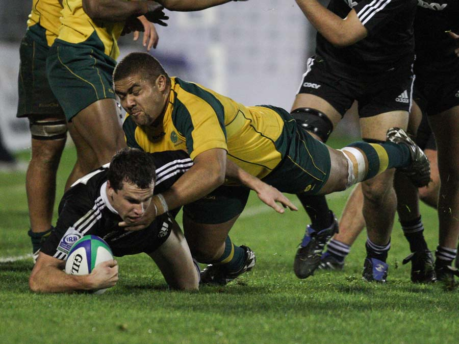 New Zealand's Tom Marshall is tackled by Australia's Paul Alo-Emile