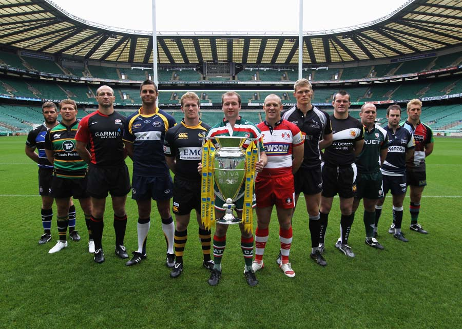 The captains of the 12 Aviva Premiership pose with the trophy