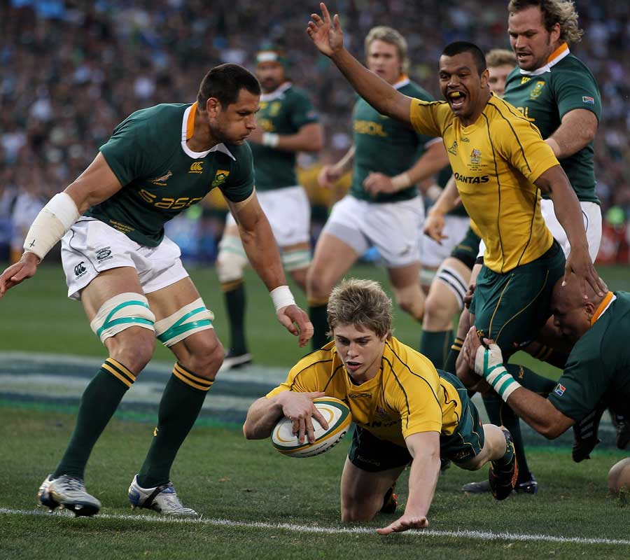 Pierre Spies can only watch as Kurtley Beale celebrates James O'Connor's first try and Australia's second