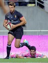 Toulouse's Vincent Clerc leaves the Stade defence in his wake