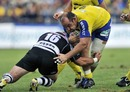 Clermont's Mario Ledesma is tackled by Brive's Benoit Cabello