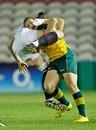 Australia's Sharni Williams tackles England's Emily Scarratt