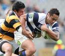 Taranaki's George Pisi tackles Auckland's Ben Atiga