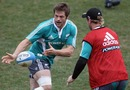 All Blacks skipper Richie McCaw gets an offload away during training