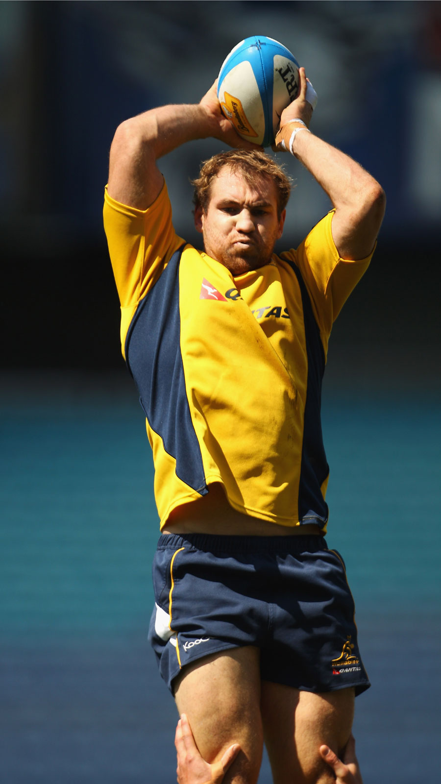 Wallabies captain Rocky Elsom is launched into the air to claim the ball