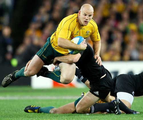 Australia's Stephen Moore is snared by an All Black tackler