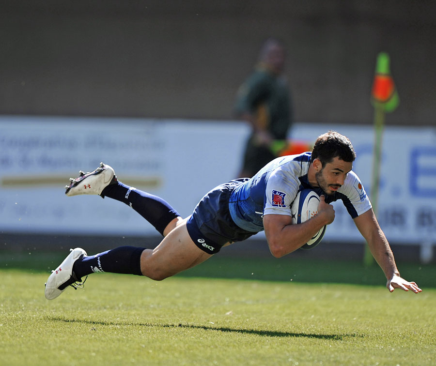 Montpellier's Geoffrey Doumayrou dives over