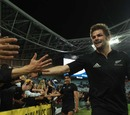 All Blacks skipper Richie McCaw celebrates victory with fans