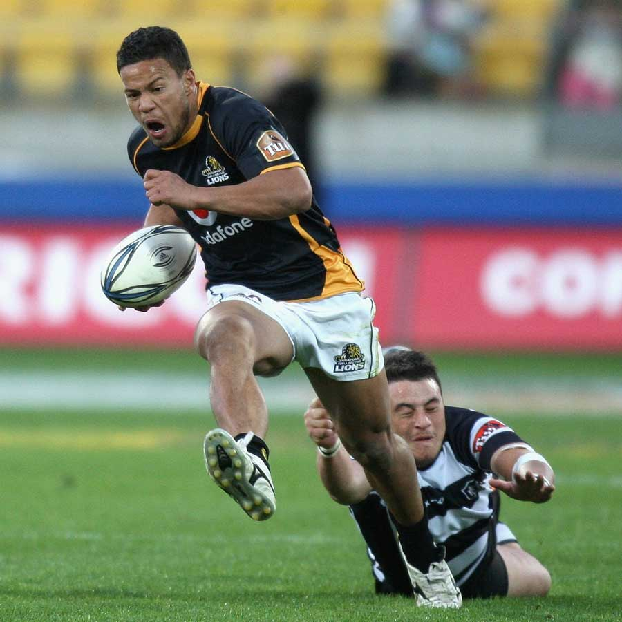 The Lions' Alapati Leiua escapes the clutches of Ryan McLeod