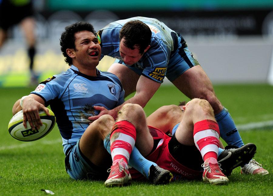 Cardiff Blues centre Casey Laulala celebrates his try