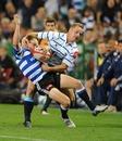 Griquas fullback Riaan Viljoen gets to grips with Dewaldt Duvenhage