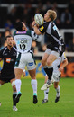 Newcastle's Alex Tait vies with Dan Bowden for a high ball