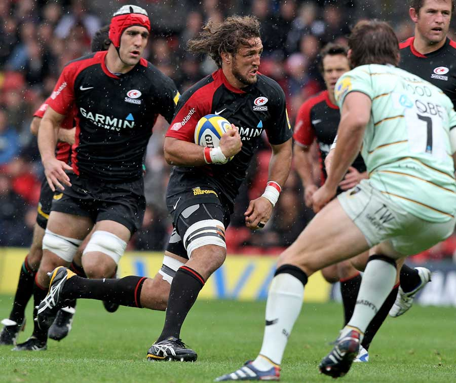 Saracens' Jacques Burger takes the attack to Northampton