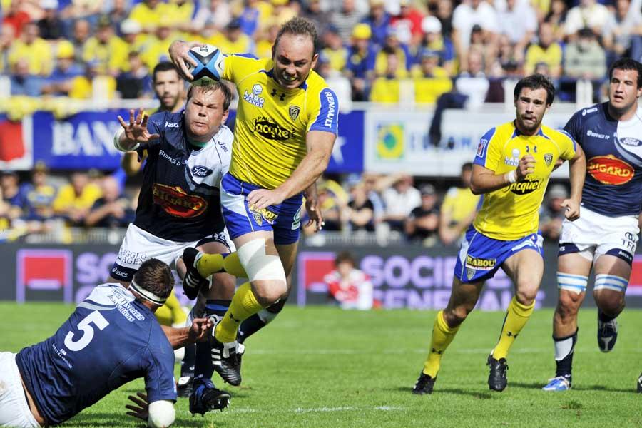 Clermont centre Marius Joubert breaks the line against Agen