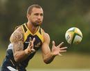 Australia's Quade Cooper claims a pass