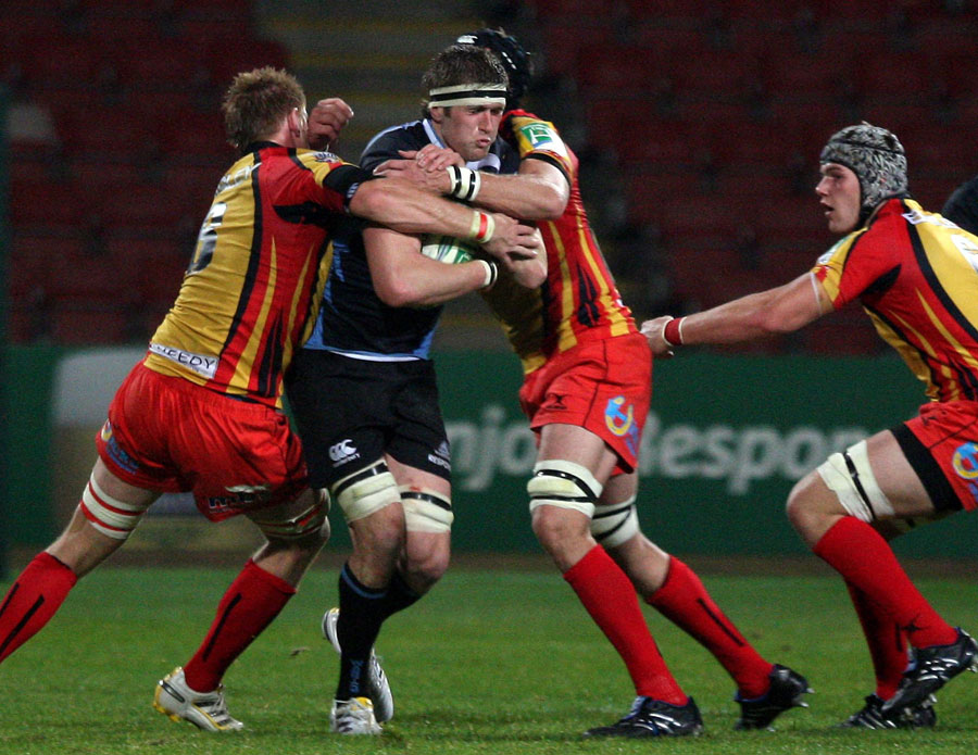 Glasgow's Richie Vernon tries to barge through the Dragons defence